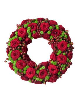 Rouwkrans met rode rozen